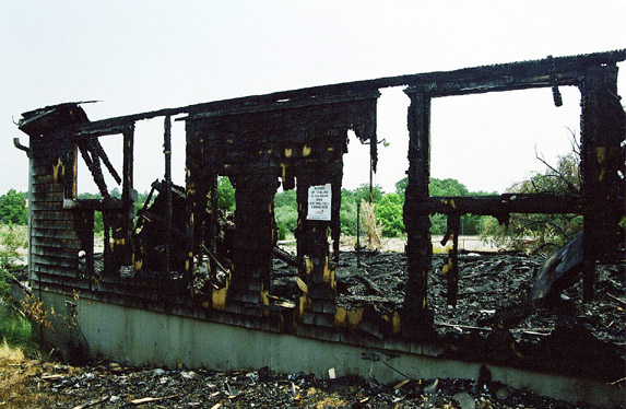 The LP House. A reward is posted for info about who burned it. 2002